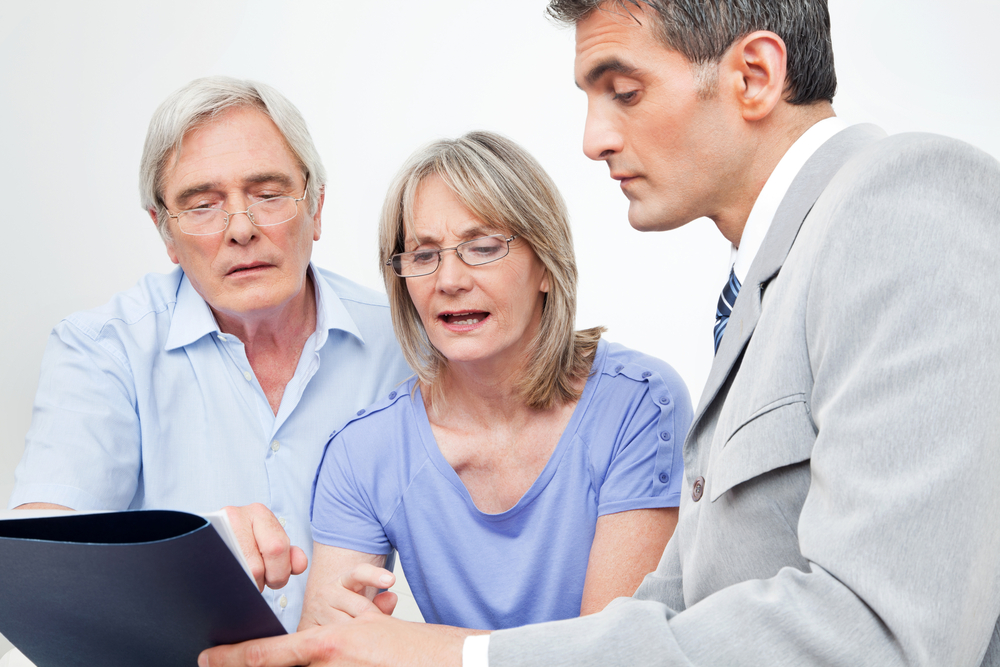 Couple getting pensions advice from financial adviser